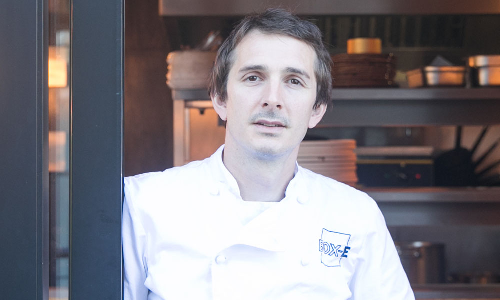 chef elliott lidstone at the entrance to his restaurant, box-e bristol